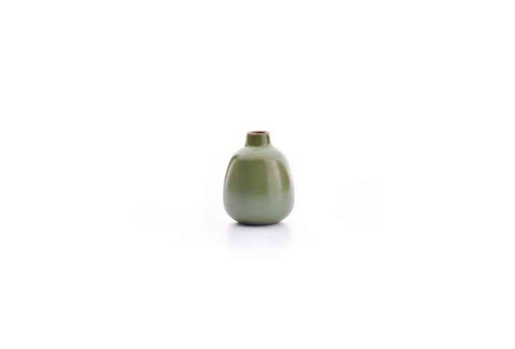 The Heath Ceramics Bud Vase, shown in olive, is $ at Heath Ceramics.