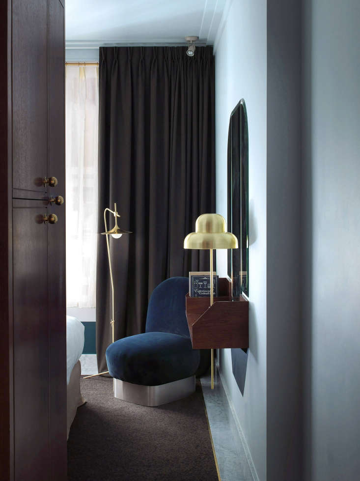 The guest quarters are done in four different color palettes. No two rooms are exactly alike, but all have playful brass lighting designed for the setting. Photograph by Paul Bowyer.