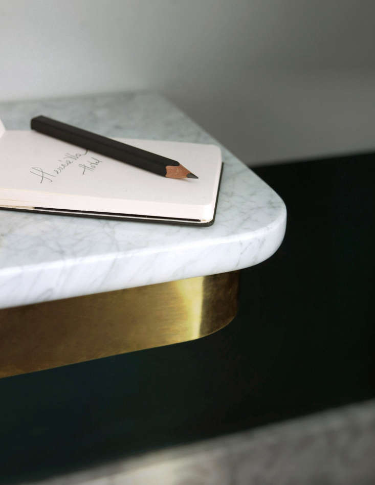 To lighten the look of the rooms, many of the furnishings are wall hung, including the brass-and-marble bedside ledges. And instead of the standard hotel pen, there are carpenter&#8