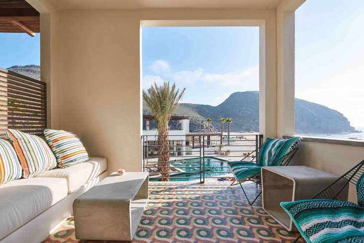 hotel san cristobal mexico covered patio colorful patterned pillows