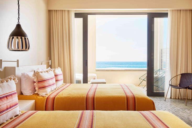 hotel san cristobal mexico yellow blankets bedroom
