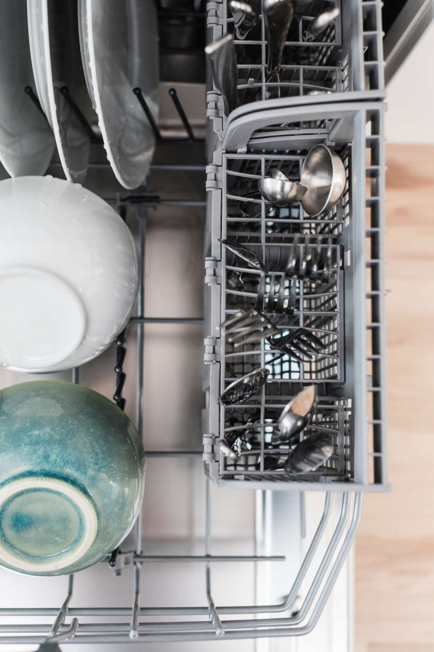 Bosch dishwashers have removable flatware compartments which can be placed along the side, or in the center, of the lower rack.