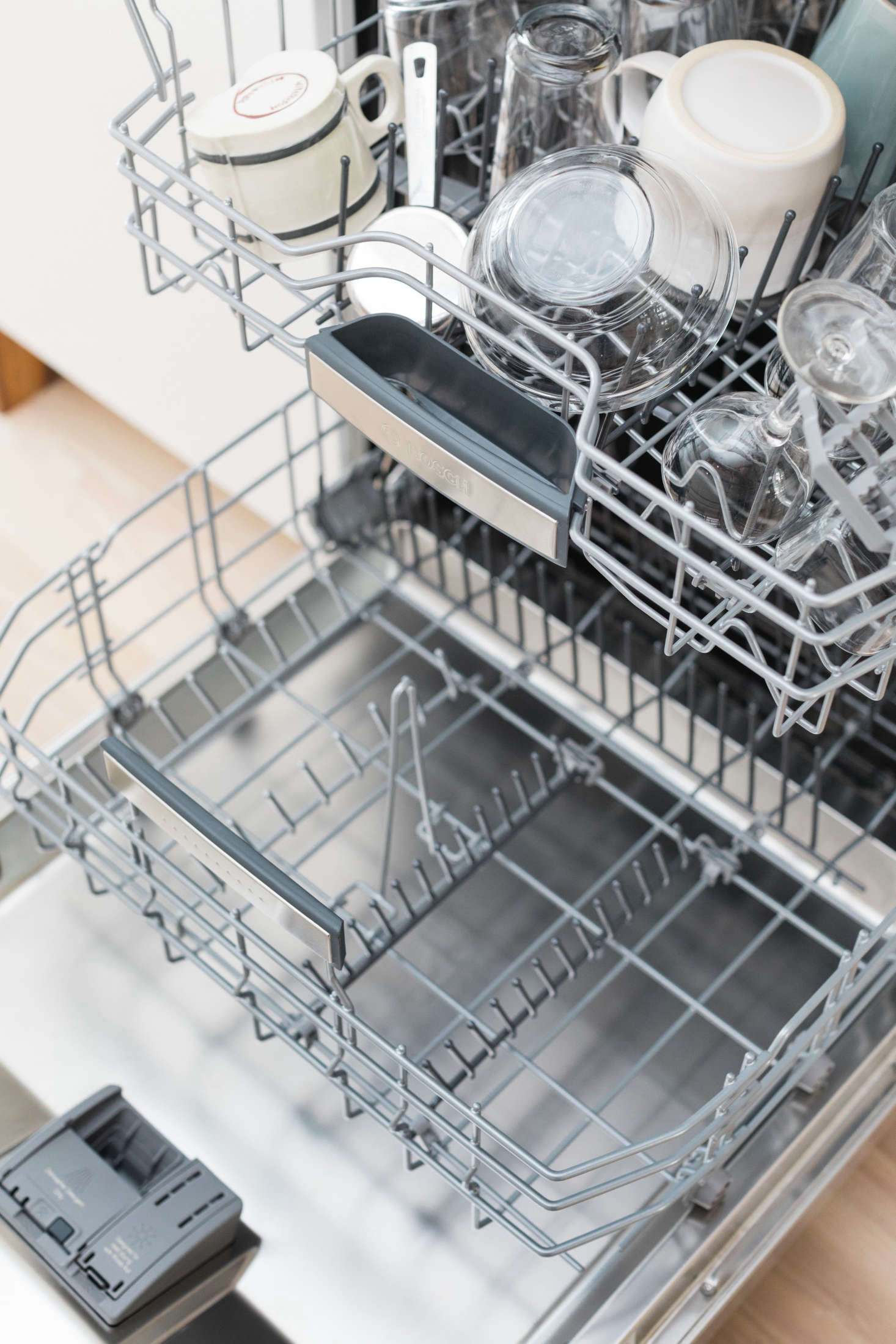 Water can pool on the bottom of cups and bowls on the top and middle racks. To avoid water drops from getting on the dry dishes below, unload the bottom rack first.