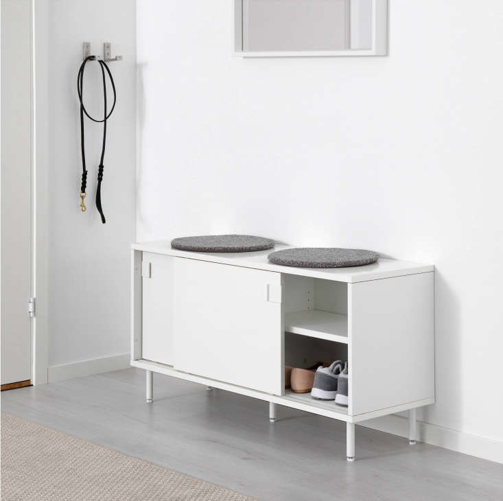 The Mackapär Bench with Storage Compartments is a bench with sliding doors for concealingshoes and other essentials.It&#8