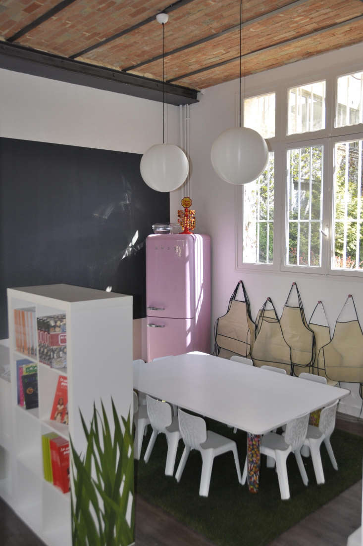 A pink fridge in the corner atShopper's Diary: Kitchen Studio in Paris.