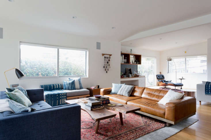 la living room oriental rug leather sofa from considered design awards