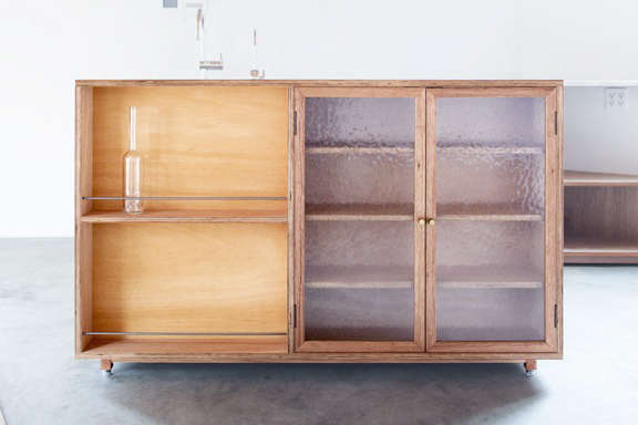 Lodge Furniture for the Urban Rustic from SNARK Japan Lodge&#8\2\17;s Lauan Cabinet, made from plywood and glass with steel and brass details;¥\108,000 (\$973.46).