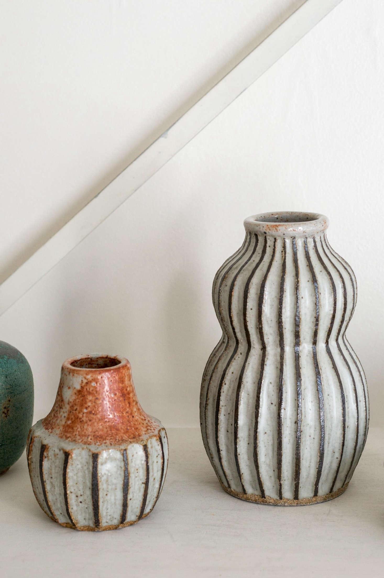Two black line vases by Malinda.