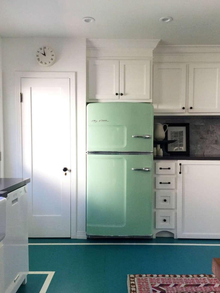 A pale green fridge from Big Chillin the LA home of graphic designer Megan Garrett,first spotted onDesign Sponge. Photograph byMegan Garrett.
