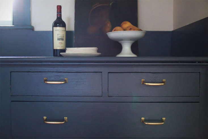 Though I do enjoy a patina, this dark room benefits from a bit of bright warmth.