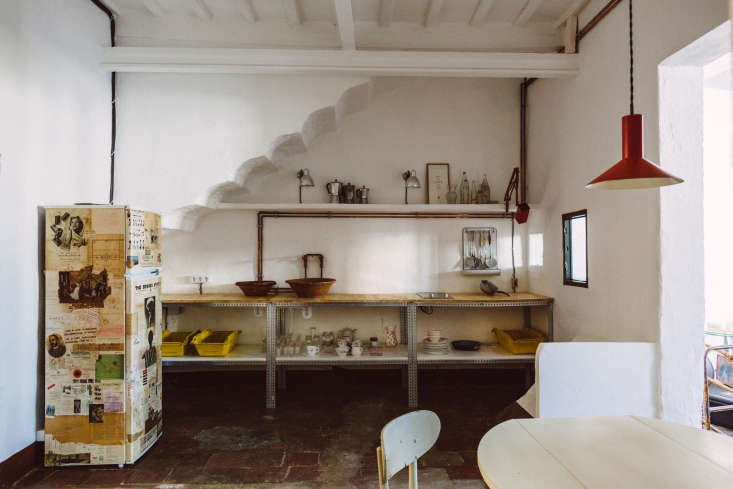 the designers outfitted a top floor guest apartment in the house with an indust 11