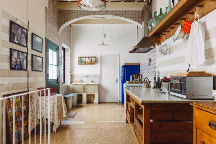 A vintage laundry sink is outfitted with a brass faucet on one side and a simple spigot on the other at Sa Calma in Menorca, Spain; see Kitchen of the Week: Embracing the Old with Quintana Partners.