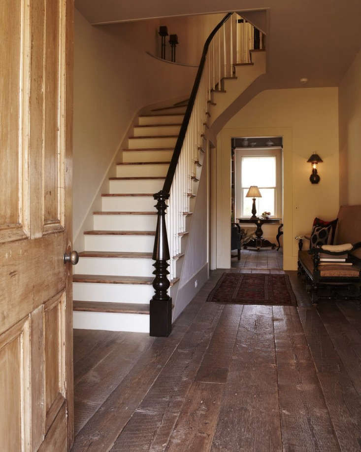 The entryway of a Vermont farmhouse withreclaimed floors; seeExpert Advice: The Ins and Outs of Reclaimed Wood Flooring.
