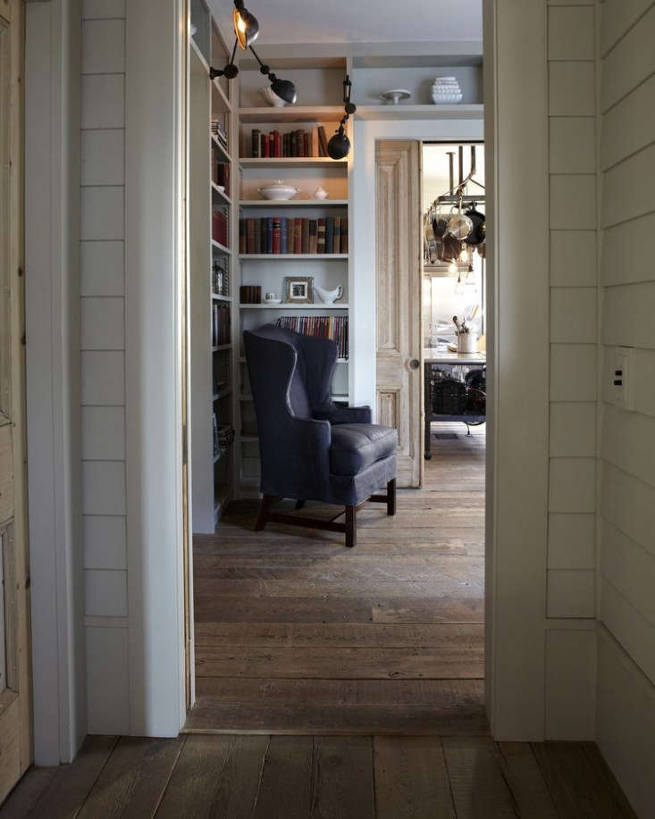 a farmhouse sitting room and kitchen usesunfinished reclaimed mixed softwoods. 14
