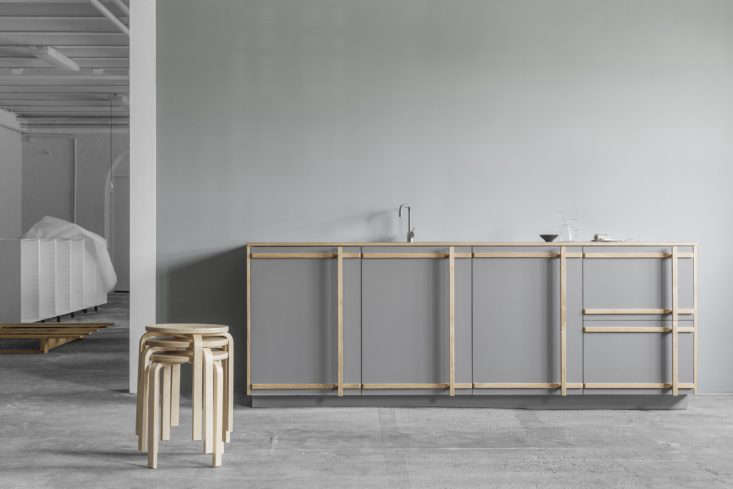 in gray with natural wood edging, the designtakes on a scandi look. 11