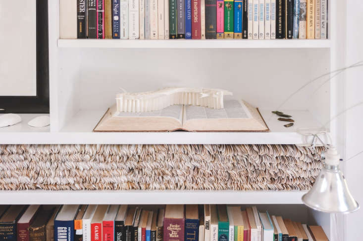 Architect Sheila Bonnell created a one-of-a-kind installation by layering razor clams on a living room shelf. Note also the paper sculpture that resembles a fish spine. See more in the Remodelista: A Manual for the Considered Home. Photograph by Matthew Williams.