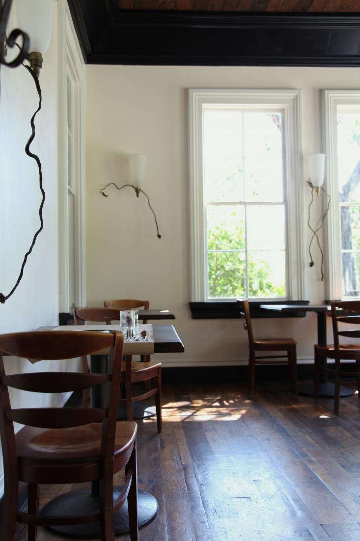 """AtSir &Starin Olema, California,Margaret Gradé andDaniel DeLong draped the wall sconces intendrilforms of dried kelp. See more atA Restaurant that Channels """"The Birds,"""" West Marin Style."""