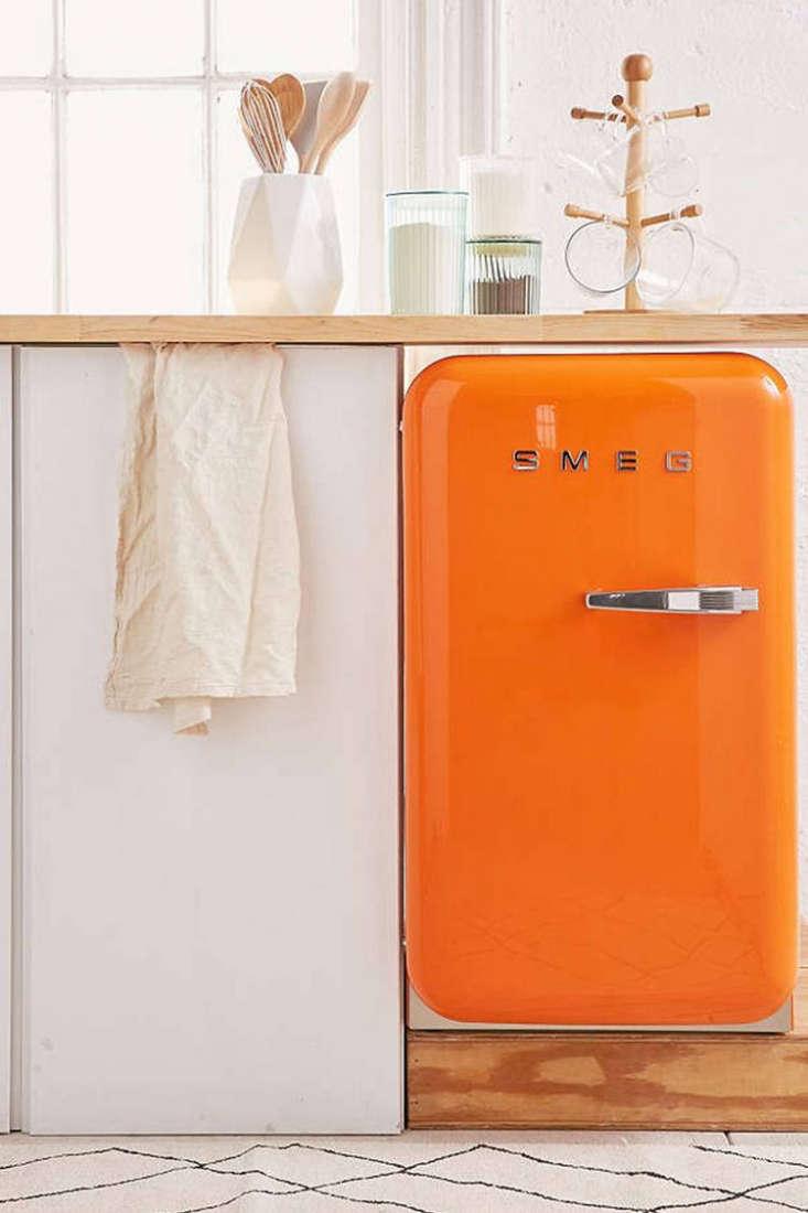 For the bold: aPopsicle-orange Smeg Mini Refrigeratorfrom Urban Outfitters.