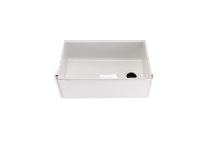 TheUniversal Fireclay Farmhouse Kitchen Sink features a convenient offset drain; $loading=