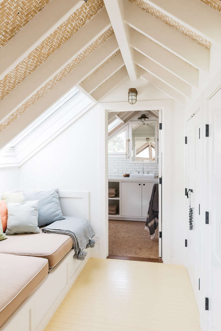 a closet and built in reading nook make use of a narrow space under the eaves. 22