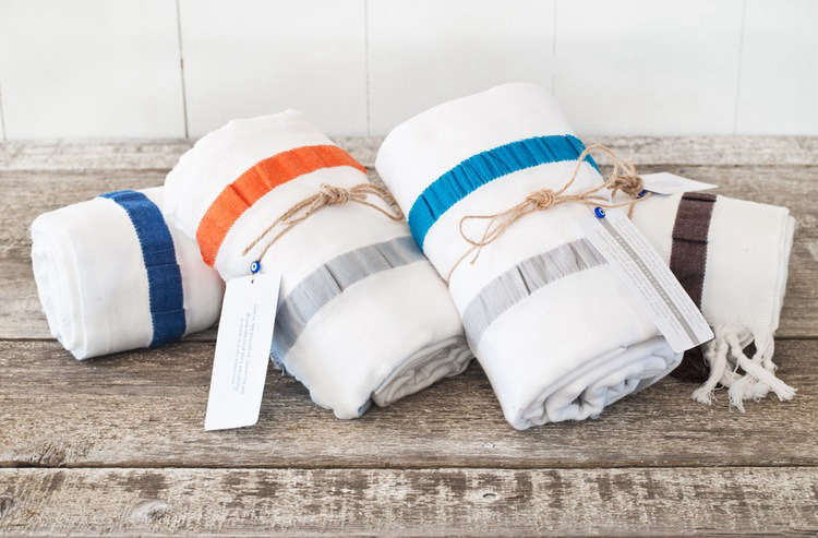 The 8 Knots Seersucker Stripe Towel, 36 by 70 inches, is made from Aegean cotton and finished with hand-knotted tassels. They&#8
