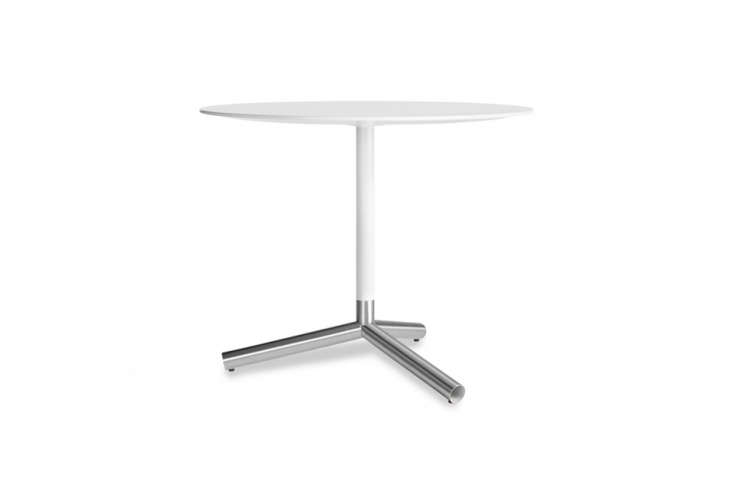 The Blu Dot Sprout Cafe Table has a powder-coated top with brushed stainless steel legs and measures 36 inches in diameter and .5 inches high; $799 at Design Public. Also available in black or yellow.