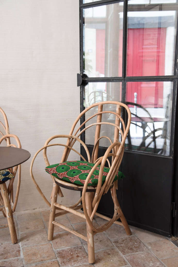 Vintage caned chairs, brought indoors, convey garden ease. Similar styles are available on Etsy.