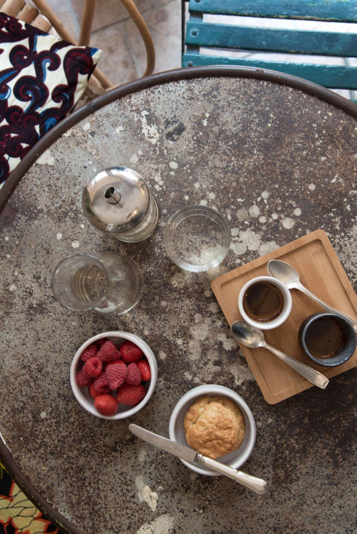On a vintage cafe table, ceramics by an Italian artisan living in Belgium mix with Japanese wooden trays and &#8
