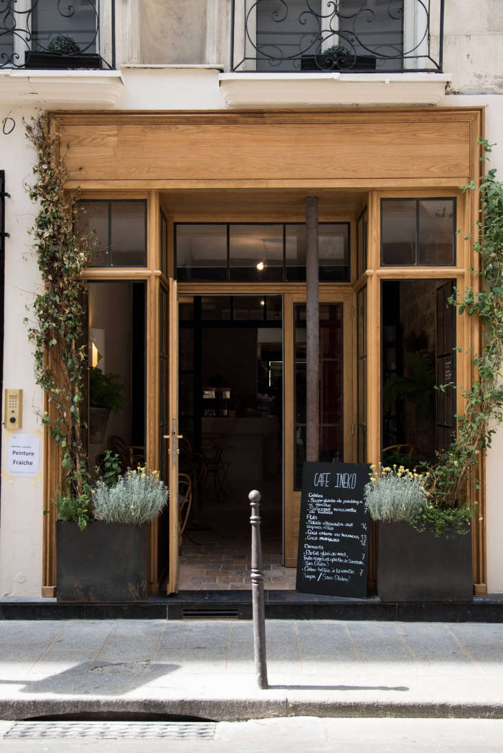 Consider curb appeal: To invite passerby into Café Ineko, de Villeneuve and Champsaur transformed the facade with new wood trim. &#8