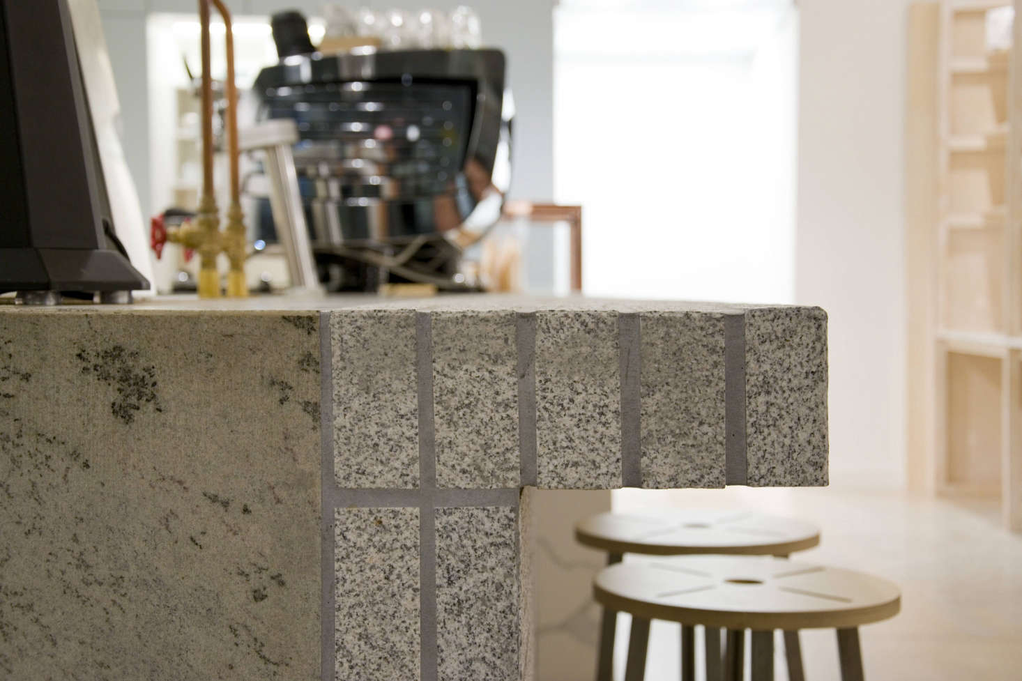 Mossy eucalyptus granite alongside granite bricks.