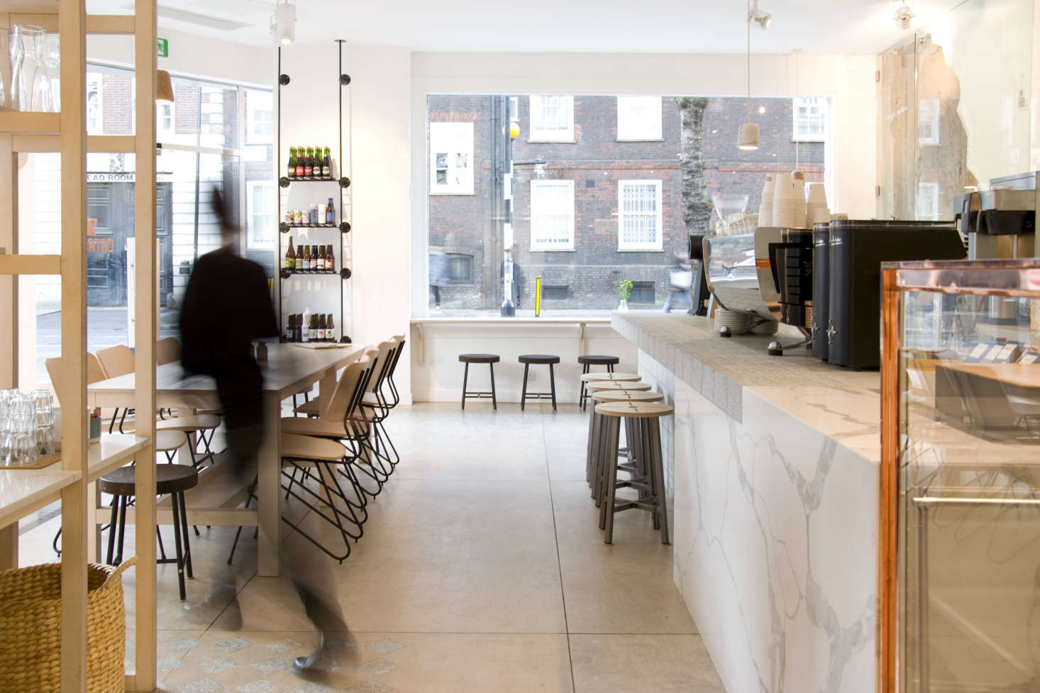 Pick what to experimentwith and what to keep simple. Even with mix-and-match stone, patterned floors, and cork and copper details, the Catalyst spacelooks bright, not busy, thanks to simple white walls: For vetted white paints, see Easy Pieces: Architect's White Paint Picks.