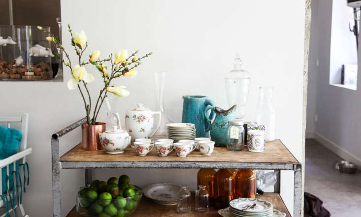 Rugged mixes well with refined: In the dining area, Prudent put a metal factory cart to use as a tea service table.