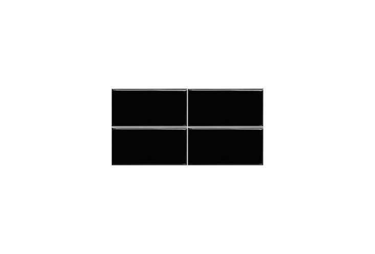 The inside of the nonfunctioning fireplace is lined with glossy black subway tiles laid vertically. For a similar look, the CNK Tile Black Ceramic Subway Tile is $79.95 for a box of loading=