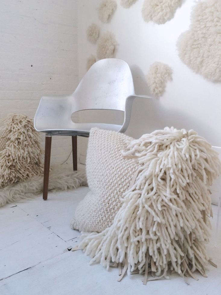 thebig veru pillow has wool and leather fringe over a hand knitted base; \$56 11