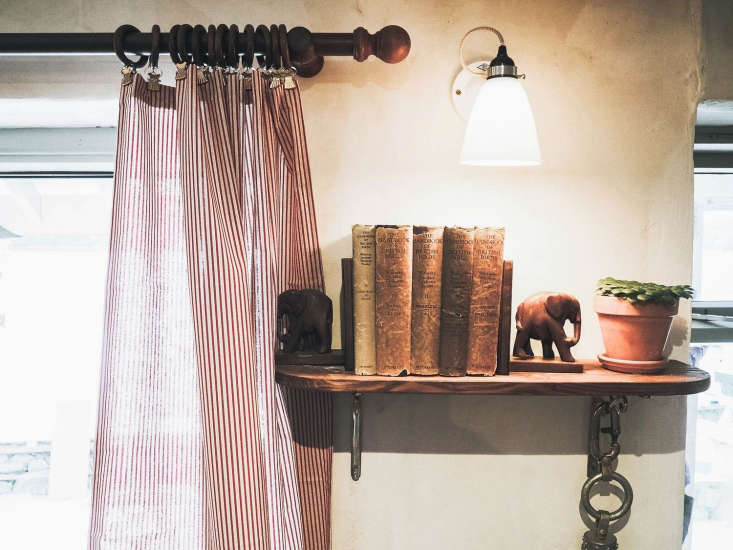 The Ferry Boat Inn 15 Ideas to Steal from a Seaside Pub in Cornwall Shelves aren&#8\2\17;t just for arm&#8\2\17;s reach: A quirky high perch holds vintage books and finds, illuminated by a Hector Wall Light by Original BTC.