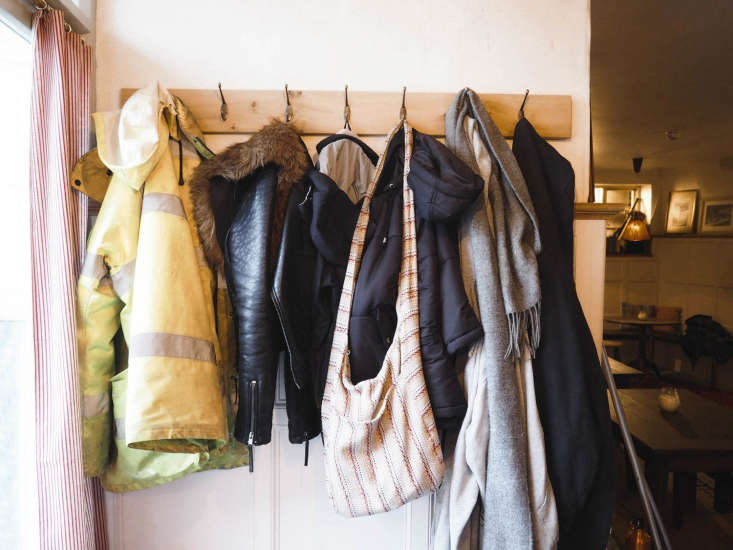 The Ferry Boat Inn 15 Ideas to Steal from a Seaside Pub in Cornwall By the door, a no frills wood plank fitted with hooks holds guests&#8\2\17; coats—a friendly touch at the pub or at home.