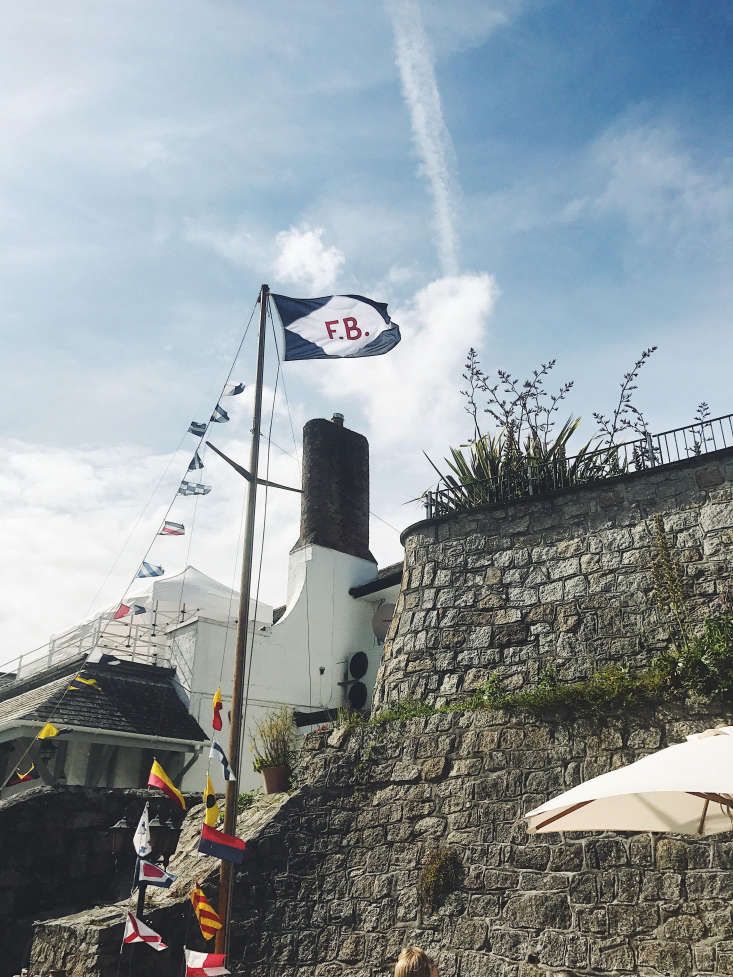 The Ferry Boat Inn 15 Ideas to Steal from a Seaside Pub in Cornwall Jaunty nautical flags hang outside. Photograph by Alex Towill.