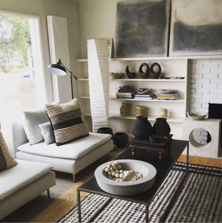 global inspired neutral black white tan living room
