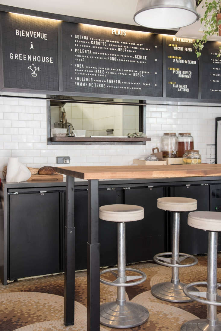 To cut costs, the team preserveda few features from the sandwich shop, includingthe menu board and the tiled floor. (The floor &#8