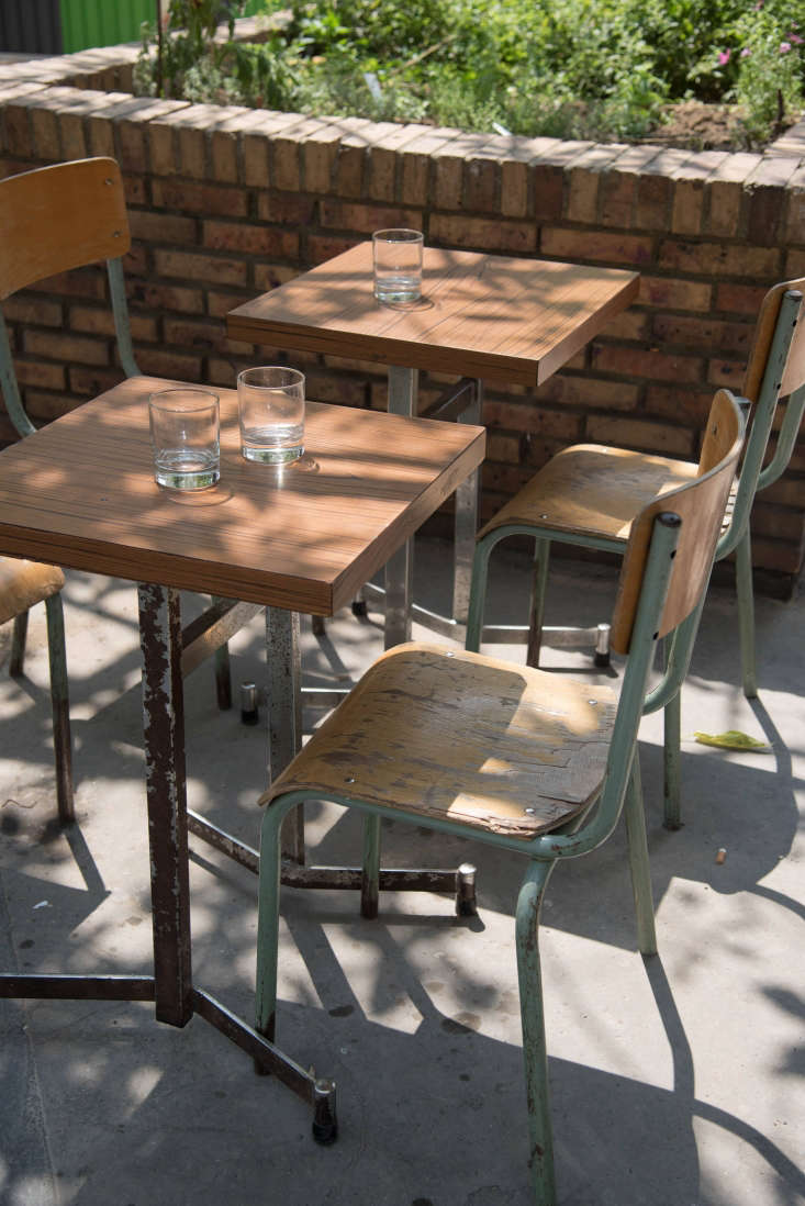 Glimpsed behind the outdoor tables:the raised-bedpotager. In order to starta working community kitchen garden on a Paris street, the team had to get authorization from the city; &#8