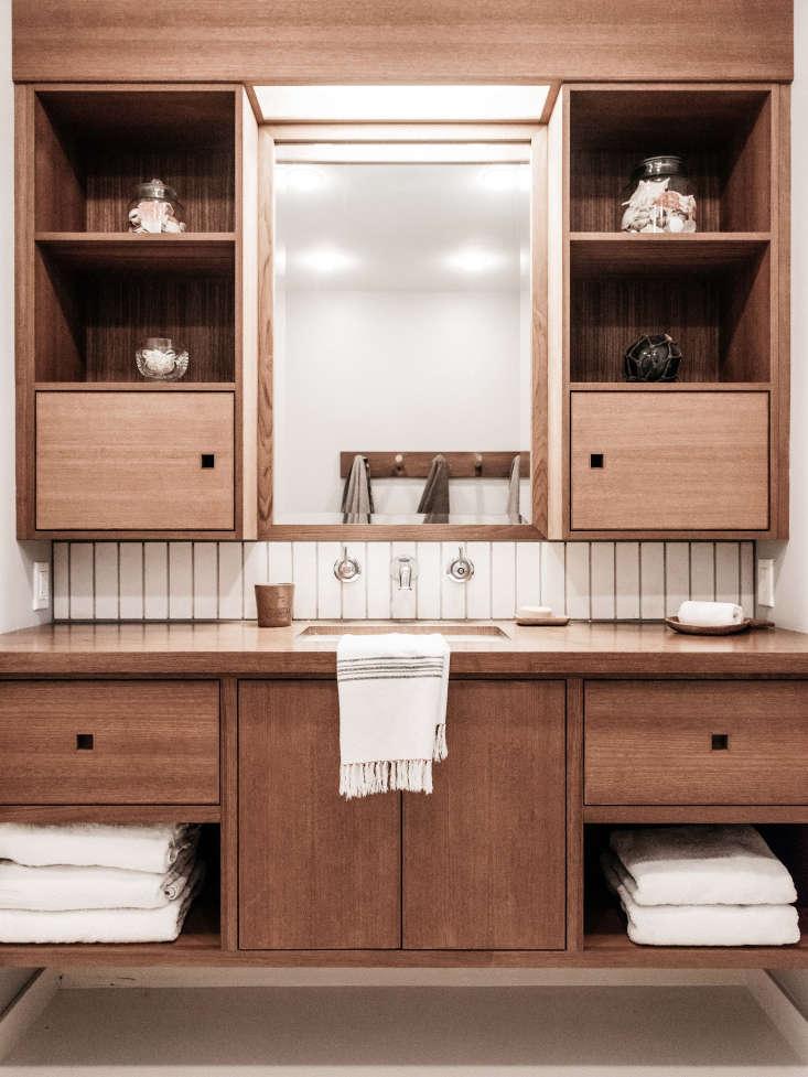 alocal cabinet maker built the custom bath vanity out ofteakwood. cutouts,  20