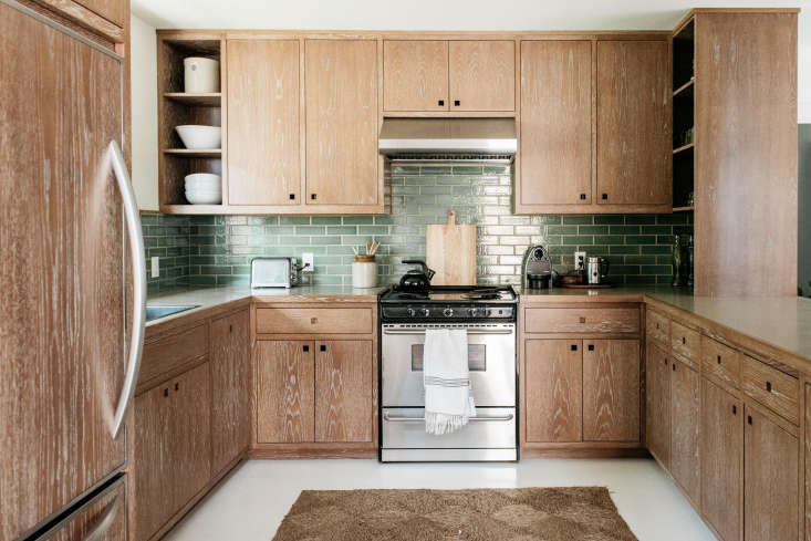 an efficient u shaped kitchen (complete with custom cerused limed wax finished  13