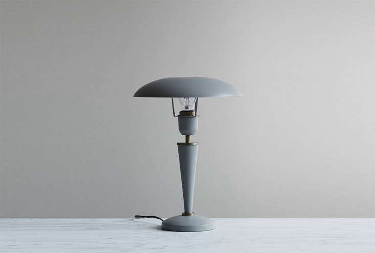 The House Doctor Opal Table Lamp, though gray, has a similar vintage s look to the table lamp on the dining room mantle. It&#8