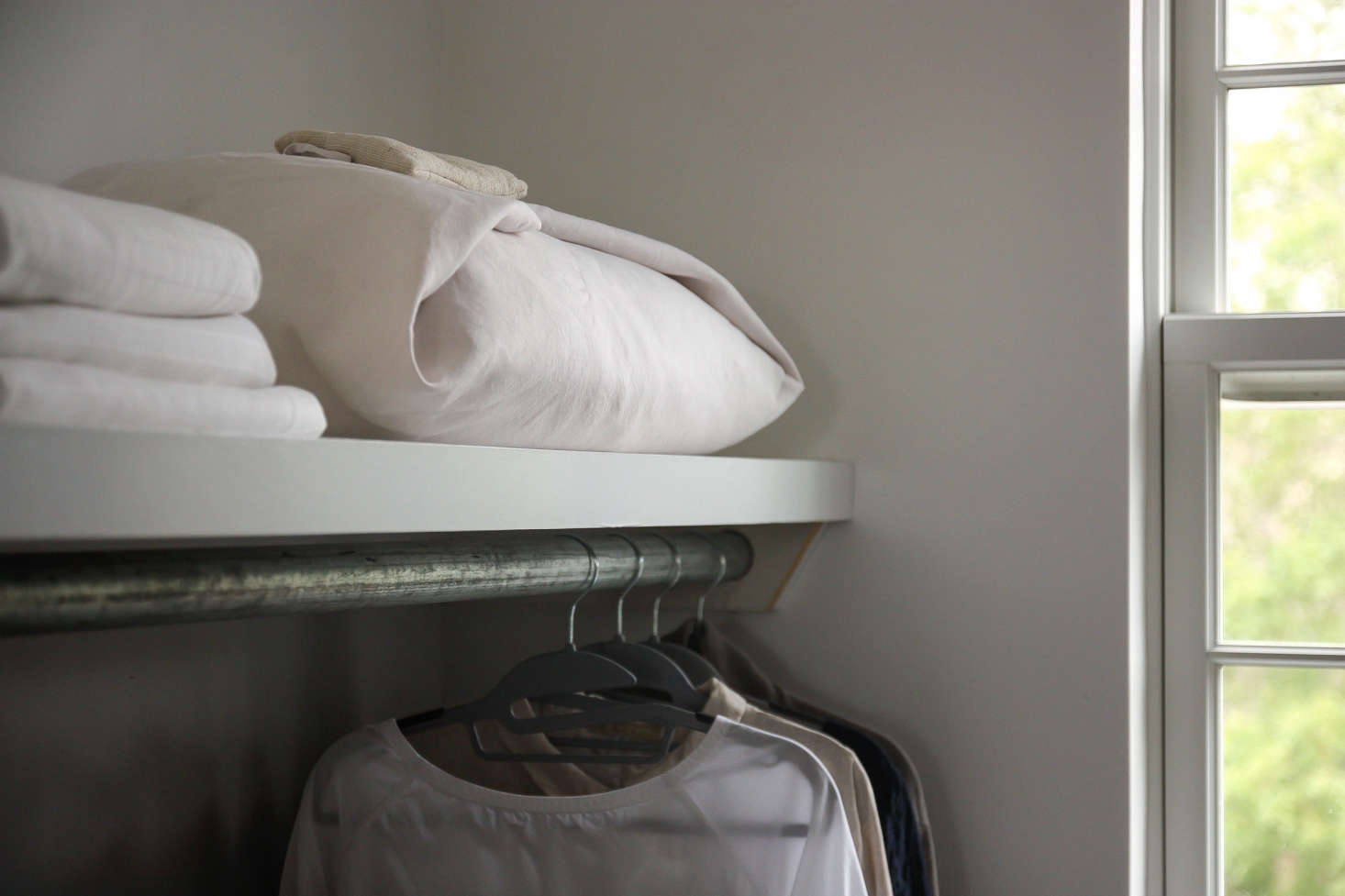We stored an extra duvet wrapped in an old linen sheet, folded furoshiki-style.