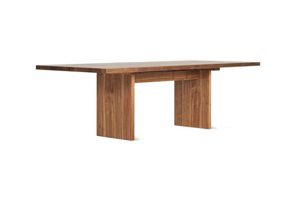 The dining table in the farmhouse was designed by Givone and made custom for the space out of two-inch-thick pine. For something similar off-the-shelf, Jacob Plejdrup&#8