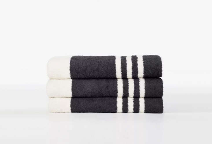 the james perse narrow stripe beach towel is made from japanese cotton; \$\2\25. 16