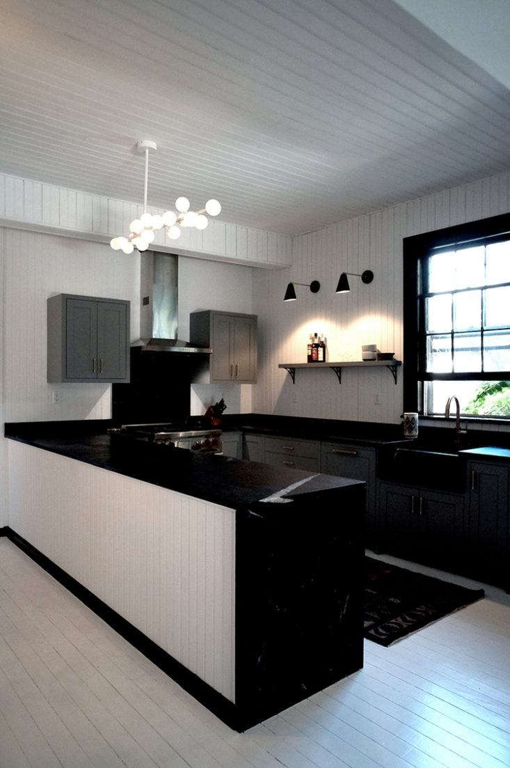 Why stop at one wall?Architect Kevin Greenberg created the ultimate loft kitchen with paneling on the walls and ceiling. (SeeBefore and After: A Tuxedo Park Carriage House Gets an Update in Black and White.)