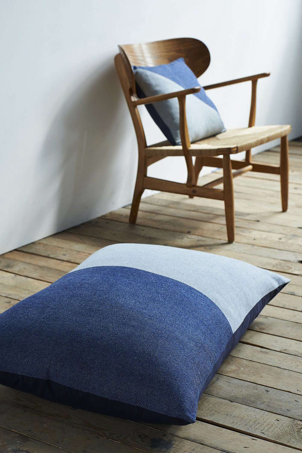 The generously proportioned Indigo Cotton Floor Cushion is backed with a heavy navy cotton drill; £0 ($8.36).