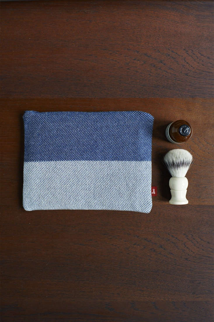 like the oblong bag, the flat pouch indigo cotton wash bag is lined with a prot 14