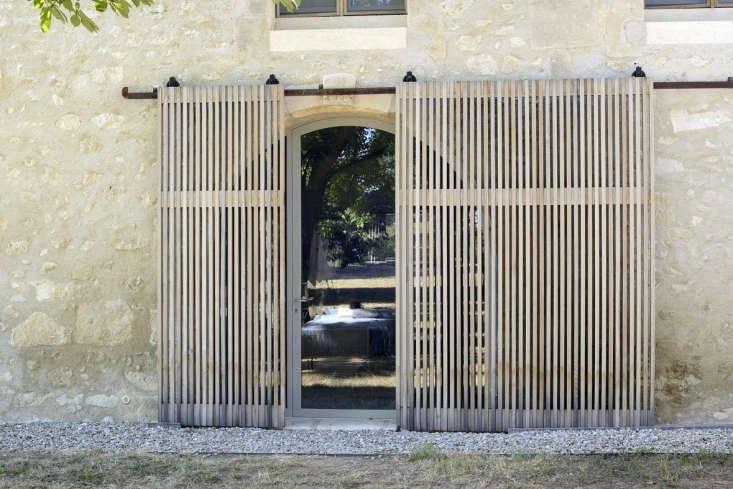 the firm addednew windows and cedar slats to the facade. 18